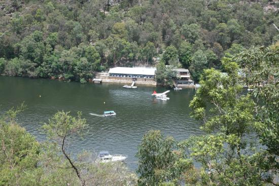 Berowra Waters Inn. A seaplane leaves as the customer boat arrives